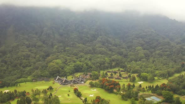Thumbnail for Panoramic View of a Golf Club in the Mountains Wrapped in Fog on the Island of Bali, Bedugul