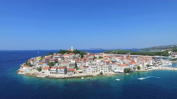 Thumbnail for Aerial view of motorboat passing in front of Primosten, Croatia