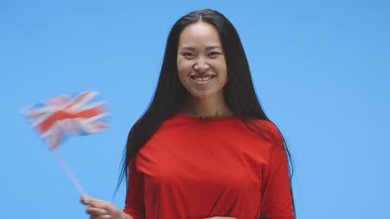 Thumbnail for Young Woman Waving with UK Flag