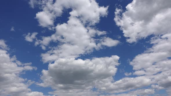 4k Timelapse, white clouds moving across the blue sky in the sunlight