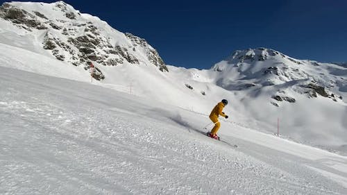 Slow Motion Video Sporty Man Skiing in Short Turns