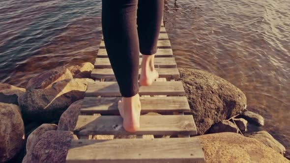 Thumbnail for Woman Walking Barefoot on Jetty