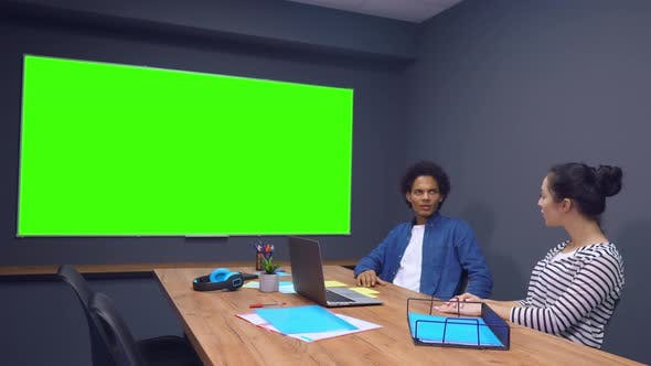 Thumbnail for Man and Woman Discussing Information on TV with Green Screen