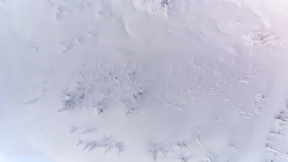 Cover Image for Pristine Untouched Powder Snow Field Overhead Aerial Background Floating Slow