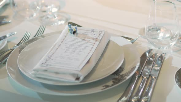 Thumbnail for Table Served for Banquet with Cutlery, Wine Glasses and Napkins. Pastel Colored Decorations.