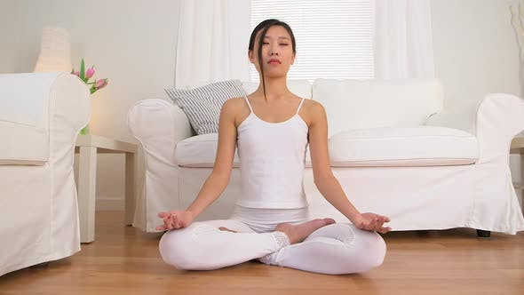 Asian woman meditating