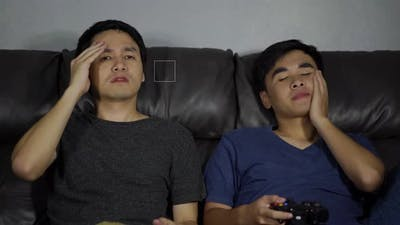 sad two man playing video games and loses