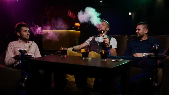 Thumbnail for Group Boys Smoking Hookah in the Lounge Caffee. Slow Motion