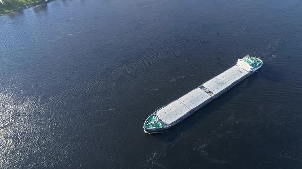 Thumbnail for Aerial Top View of Cargo Ship Floating in River