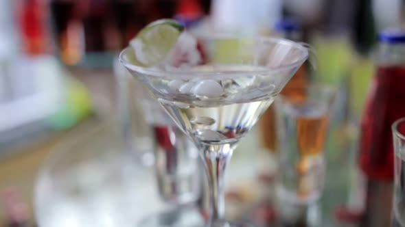 Smoking Martini Cocktail in a Conical Glass with Wafting Vapor