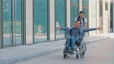 Happy Man in Wheelchair with Wife