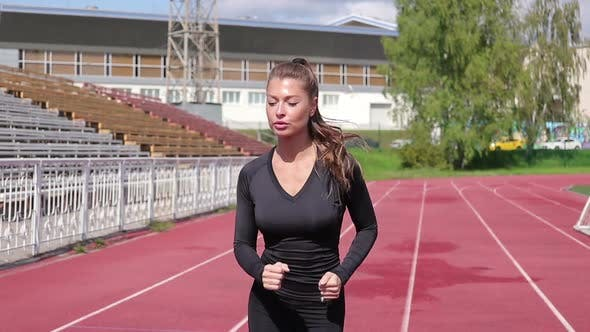Thumbnail for Slim Sweaty Woman Running on Athletic Field