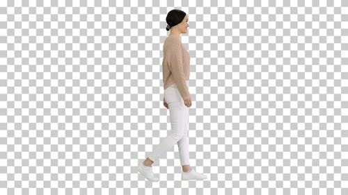 Relaxed young woman walking towards and, Alpha Channel