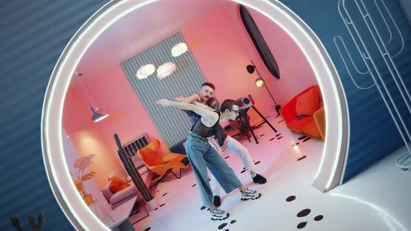 Thumbnail for Two Stylish Men Dancing Vogue in Trendy Studio with Illumination