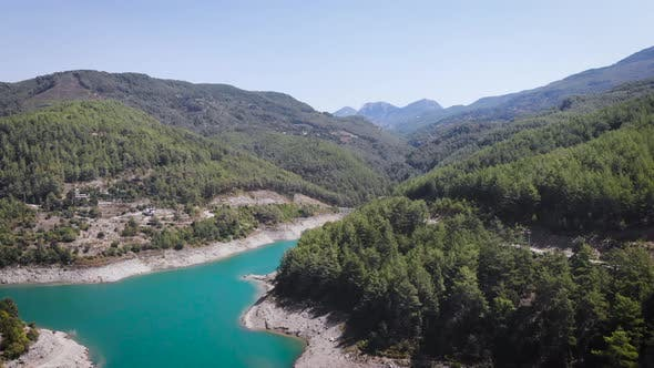 mountain river with green trees stones at bank 4k aerial bird eye view above