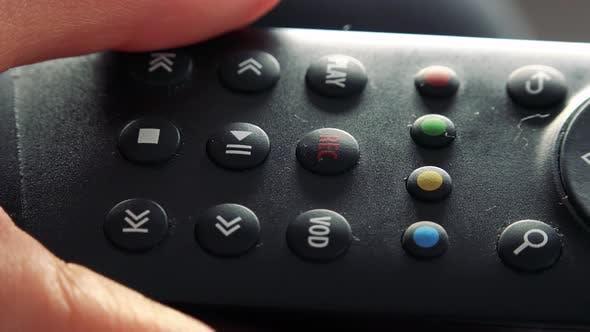 Thumbnail for A Woman Presses a Record Button on a Remote Control - Closeup