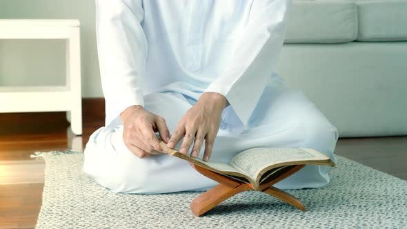 Thumbnail for Asian Muslim Man Reading the Qur'an