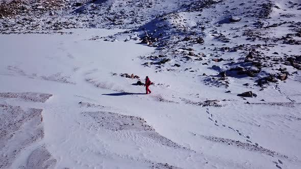 One Climber Is Walking Among the Snowy Mountains