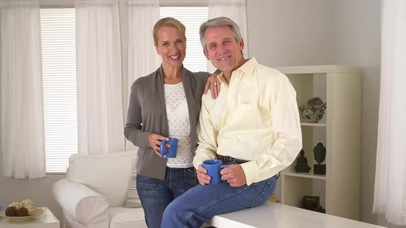 Thumbnail for Portrait of happy senior couple in living room