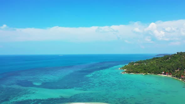 Thumbnail for Daytime above island view of a sunshine white sandy paradise beach and turquoise sea background in b