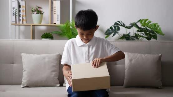 Boy opening gift box