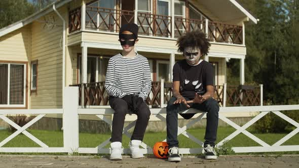 Thumbnail for Two Boys in Halloween Costumes