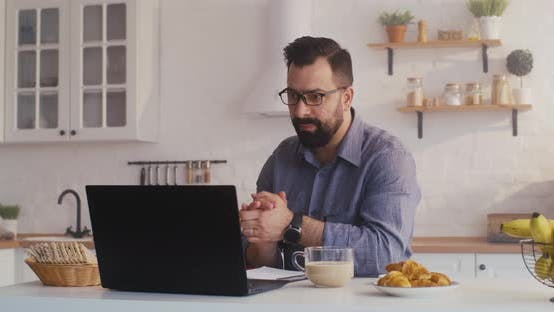 Thumbnail for Man Having a Video Call in the Kitchen