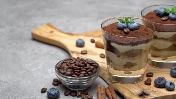 Thumbnail for Classic Tiramisu Dessert in a Glass with Blueberries on Concrete Background