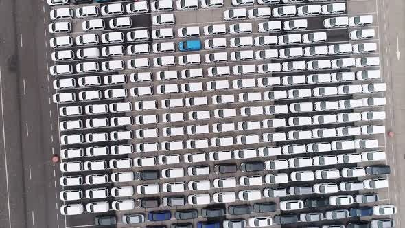 Thumbnail for Flying Above Storage Parking Lot Of New Unsold Cars