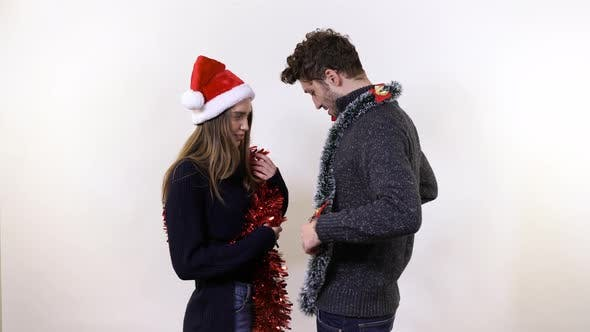 Thumbnail for A young couple playing with tinsel