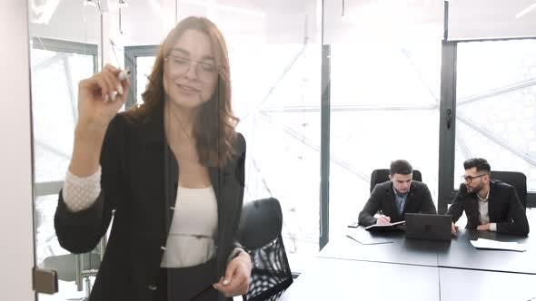 Young Pretty Smart Woman Working at Office