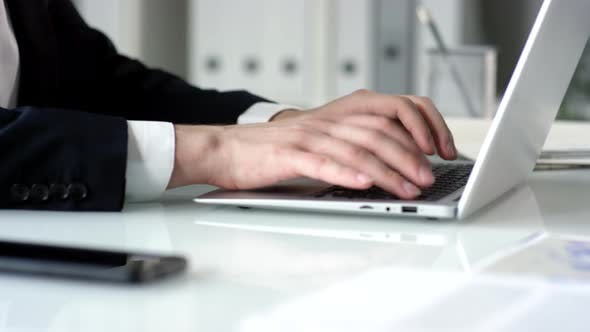 Thumbnail for Hands of Businessman Typing on Laptop at Office Desk