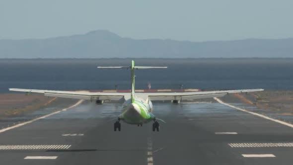 Jetliner Arrival. Airplane Landing on Runway By the Sea