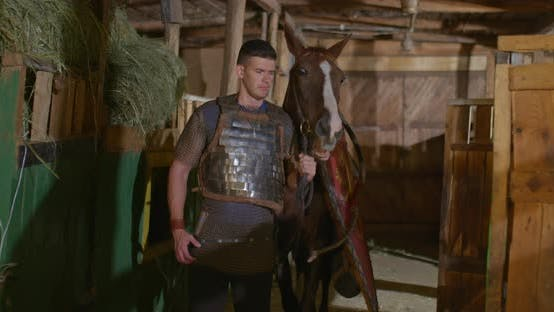 Portrait Warrior Armor Chain Mail Leads Horse Out Stable