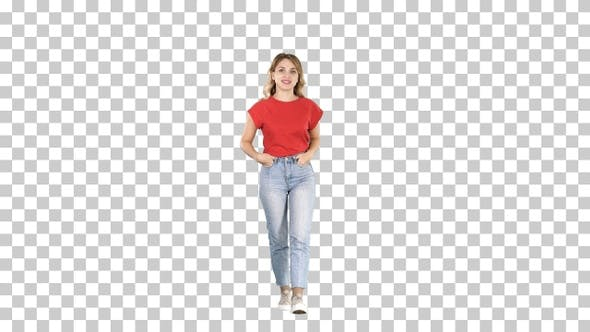 Thumbnail for Blond woman walking with hands in her pockets and talking