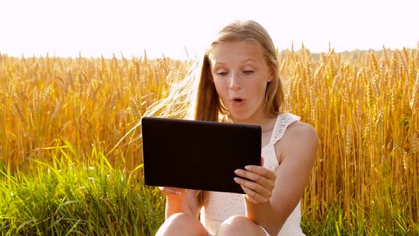 Thumbnail for Smiling with Tablet Computer on Cereal Field