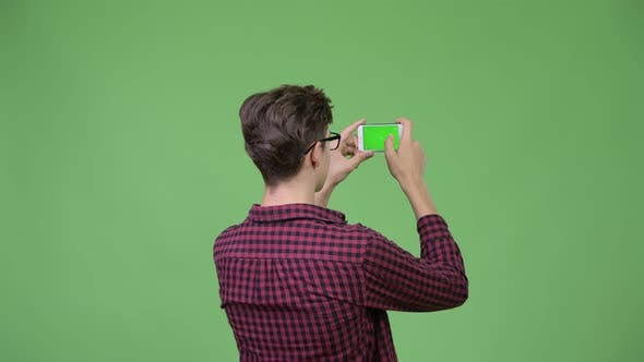 Thumbnail for Young Handsome Teenage Nerd Boy Photographing with Phone