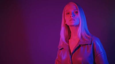 Young Fashion Woman Moves Smoothly in Neon Light