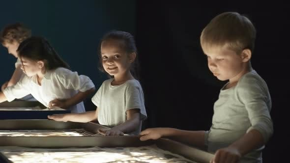 Thumbnail for Girl Smiling during Sand Animation Class
