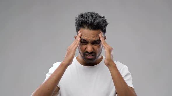 Thumbnail for Unhappy Indian Man Suffering From Headache 4