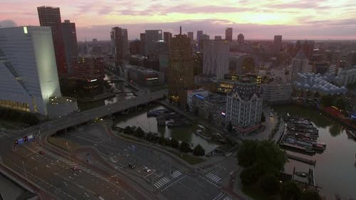 Aerial evening shot of Rotterdam cityscape and traffic