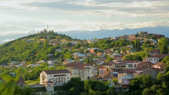 Thumbnail for Aerial View of Georgian Village on Background of Majestic Caucasian Mountains