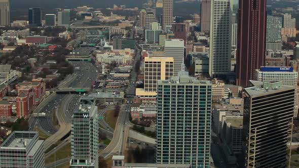Cover Image for A high angle, pan shot from left to right of the Atlanta Skyline with cars on the freeway.