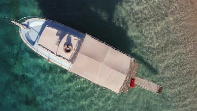 Top View of Boat on the Seashore with Turquoise Water