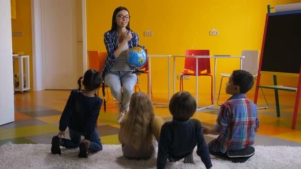 Thumbnail for Preschool Teacher Teaching Kids About Globe