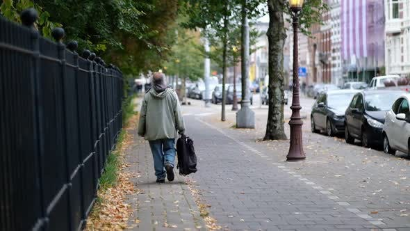 Thumbnail for Old Man Walking Slow Motion
