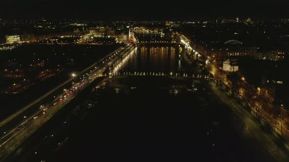 Cover Image for AERIAL: View Over Seine River in Paris, France at Night with Shining City Lights