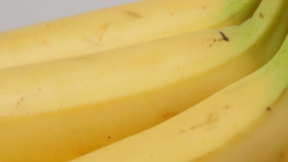 Thumbnail for Tasty banana fruit pieces arranged in a row 4K 2160p 30fps UltraHD tilt footage - Musa acuminata and