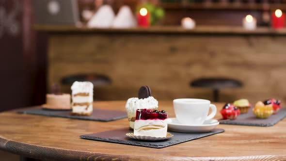 Dolly Parallax Shot on Coffee and Slices of Cakes on a Table