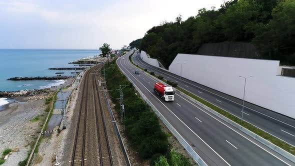 Thumbnail for Truck driving on the road along the sea coast